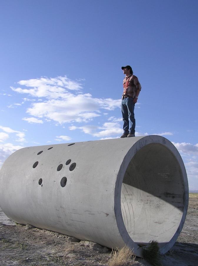 Reno artist Casey Clark surveys the Utah desert from atop one of Nancy Holt's Sun Tunnels.    Photo: Kris Vagner