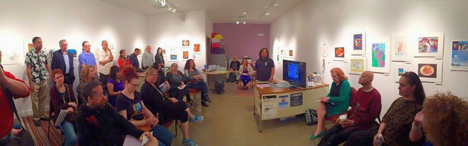 "Gig Depio, standing at desk, hosted a talk in Las vegas last week, ""Why Art Now?  PHOTO: Courtesy Gig Depio"