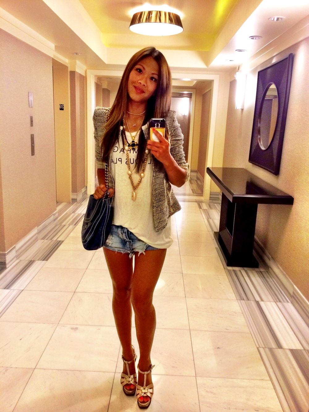 But first... A selfie! Off to dinner in my YSL Tributes, my One Teaspoon shorts, my CHAMPAGNE SIL VOUS PLAIT Daydreamer muscle tank, my Iro tweed jacket, vintage Chanel bling bling for ling ling, and my beat up Prada bag. Definitely dressed to inhale this evening!