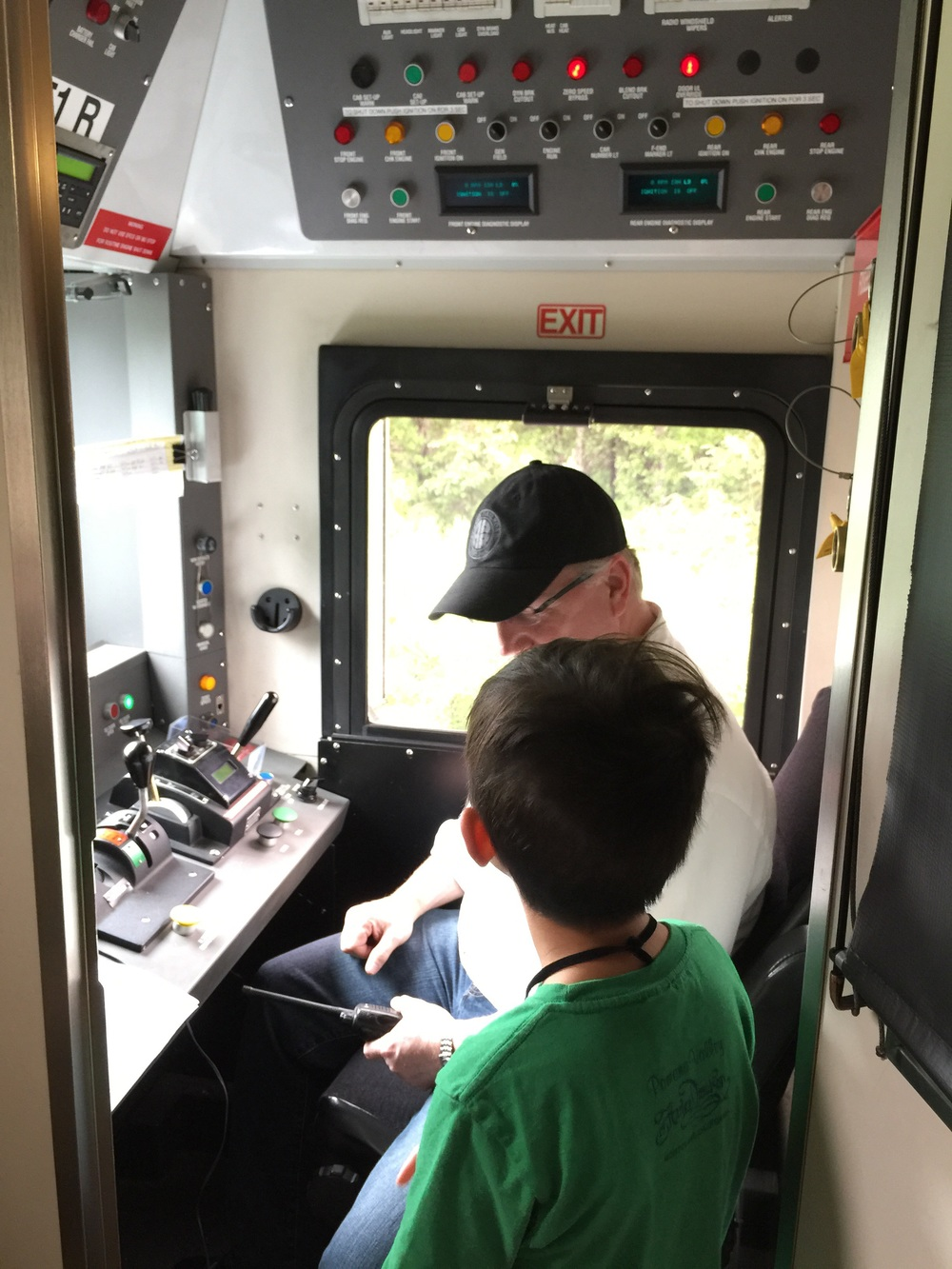Jae grilling the train conductor :-)