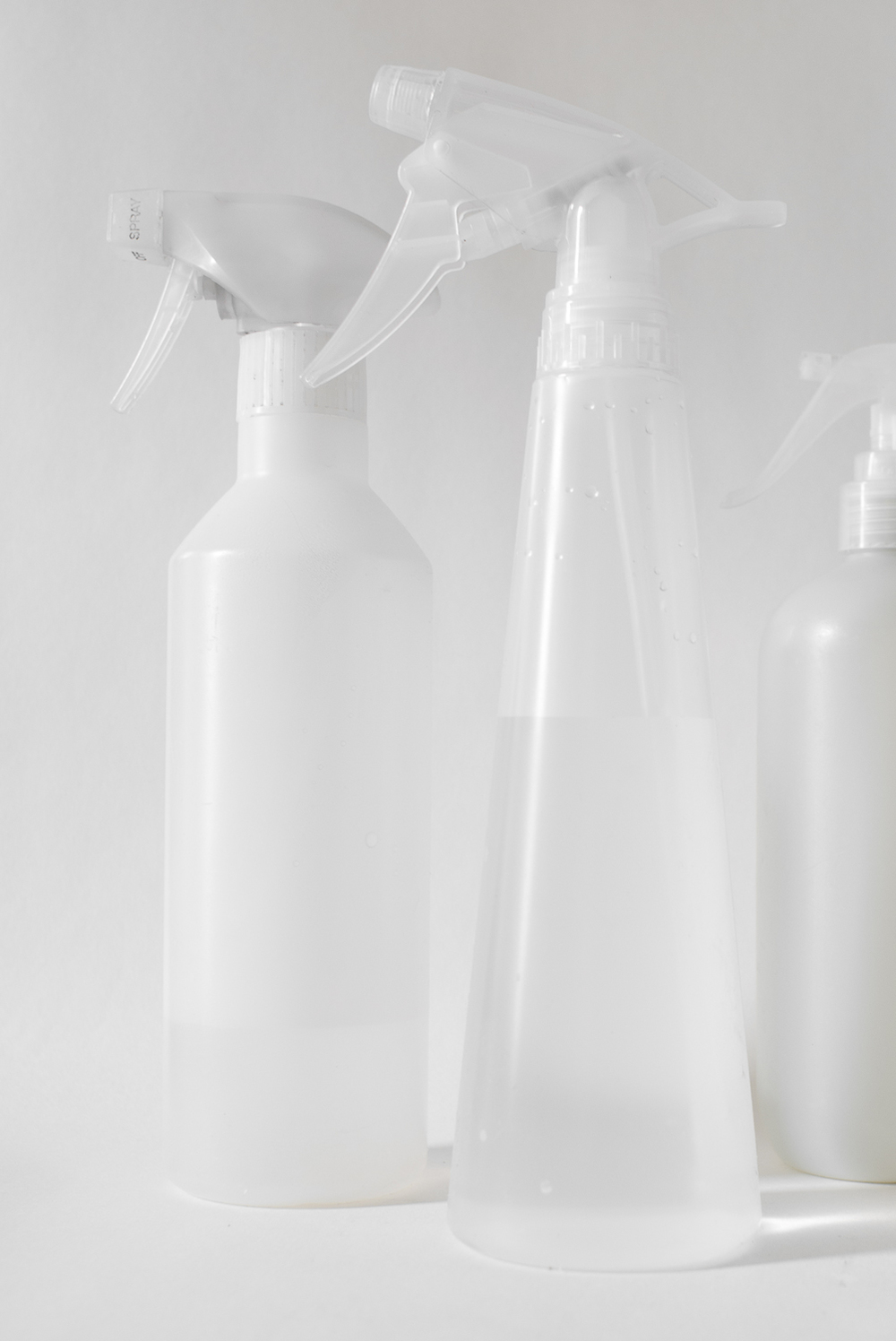From left: my favorite trusty old sprayer from Muji (now, unfortunately, discontinued, at least in Poland); the cheap Ikea version(that doesn't withstand a five-year-old's water fight use); repurposed Lilly's Eco Clean All-Purpose Spray Cleaner bottle, well-washed and stripped of its label.