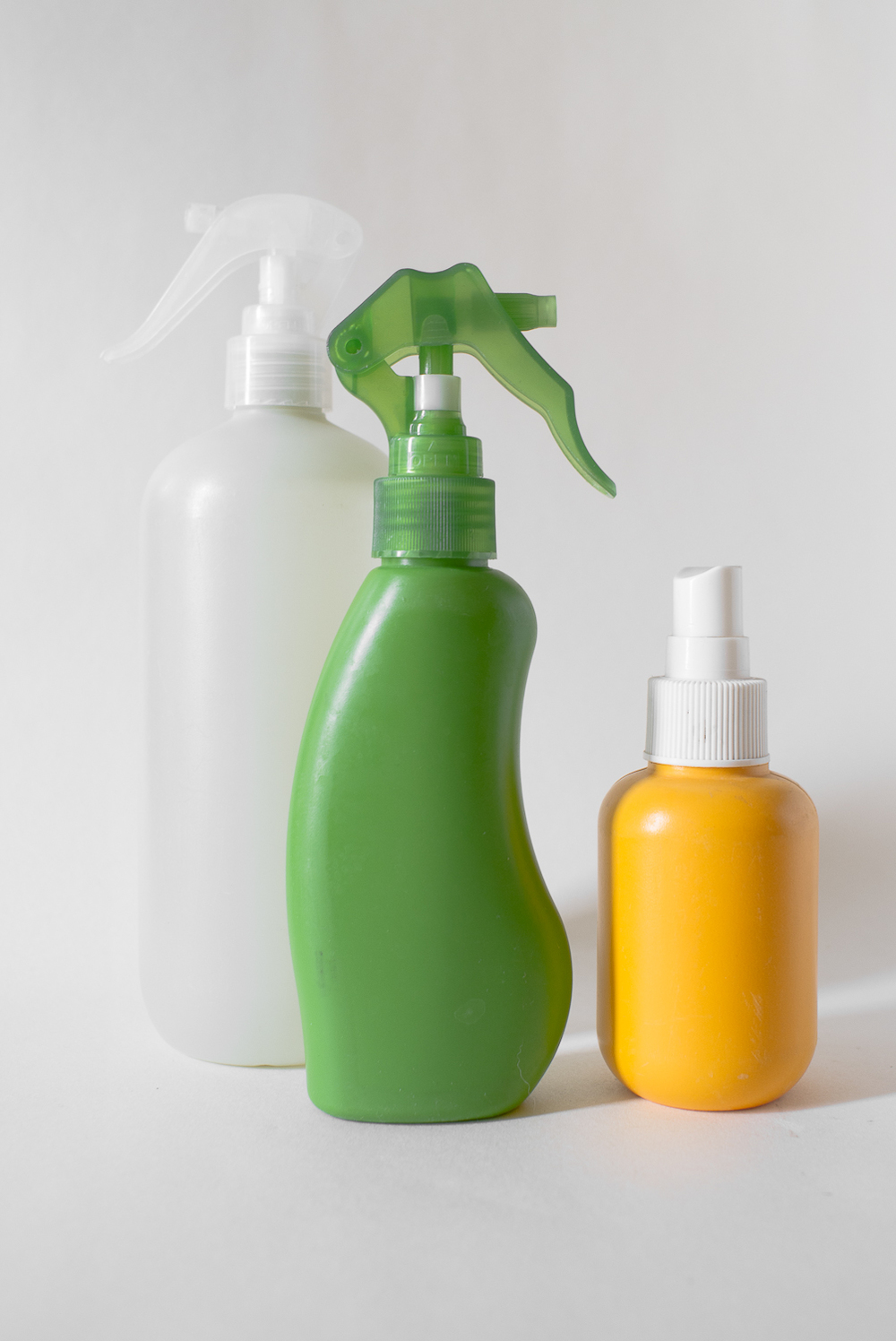Three sprayers that once held non-toxic substances for household or cosmetic use. Note how elegant they look with the labels neatly peeled off. (Note also that, depending on the adhesive used by the manufacturer, sometimes removing the label is a job for a heavy-duty solvent like lighter fluid.)