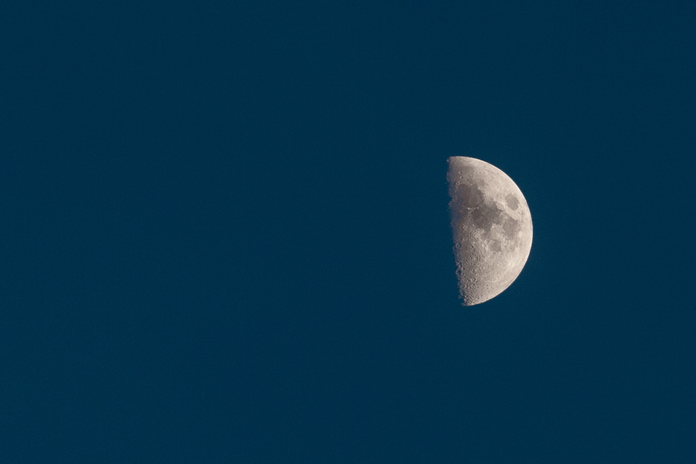 Photo taken by the author on June 12, 2016, at 20:29 in the evening in Warsaw's Mokotów with a Canon EOS Digital Rebel XT fitted with the 200mm/f2.8 L-series lens. Underexposed to show moon surface detail.