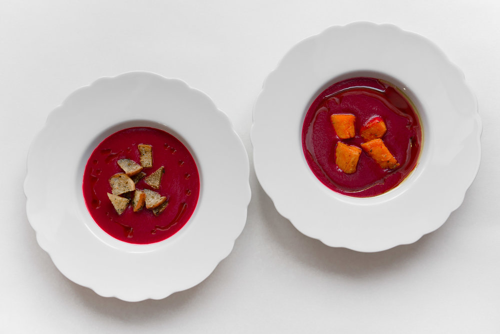 Jewel-toned cream of beet soup with rosemary boasts clean, earthy and woodsy flavors that marry well with both aromatic croutons and the spicy sweetness of roasted yams. Porcelain plates by Hutschenreuther. Photo by the author, taken in daylight with the Leica X1.