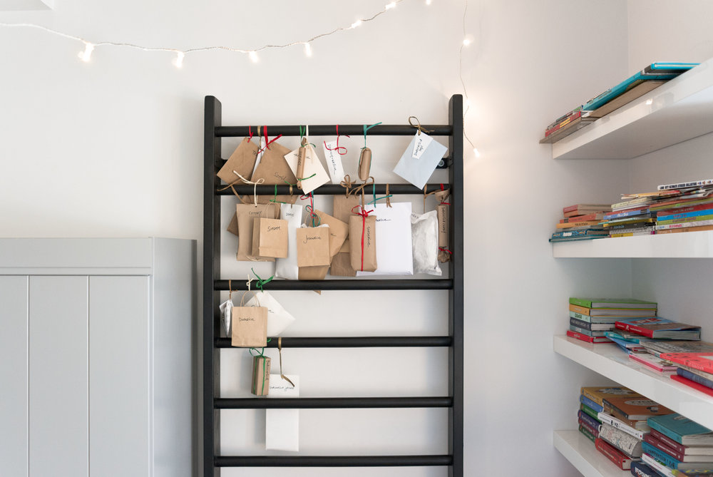 Anker's Advent calendar for 2016 makes use of the gym ladder that serves as a versatile headboard in his new room. Photo by the author, taken with the Leica X1.