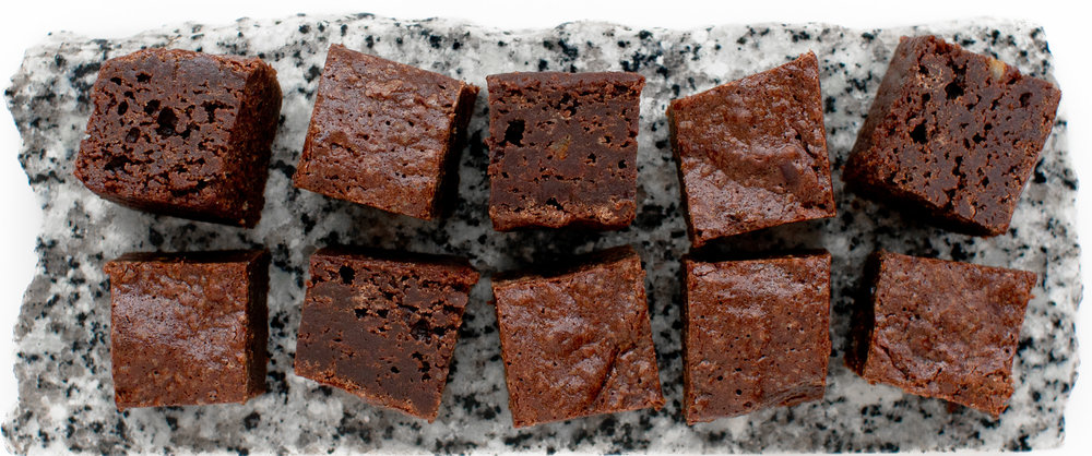 Chilled brownies carved into tiny unctuous squares and served on a cold slab of granite.