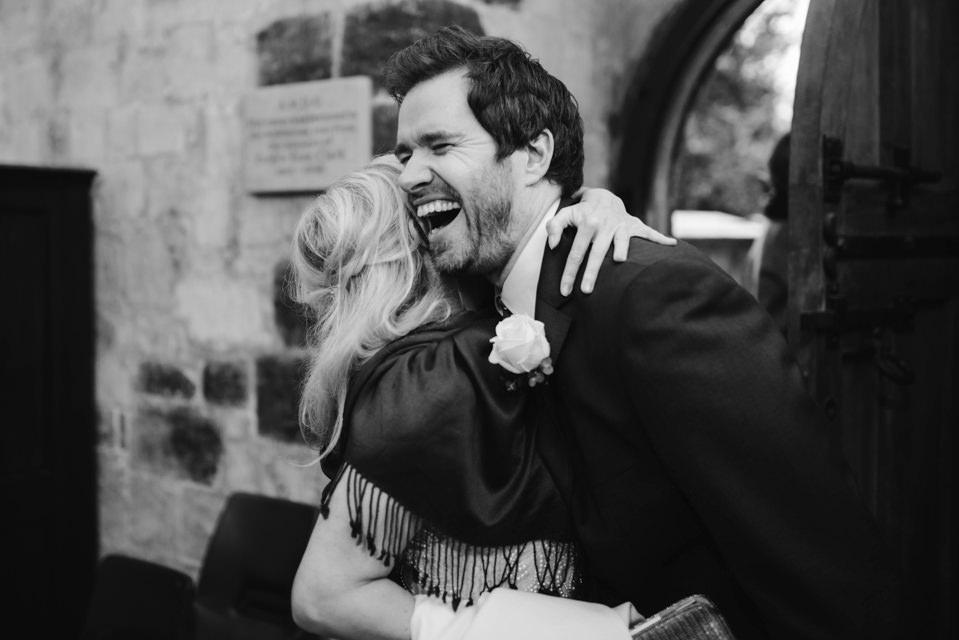 Wiltshire Wedding photography with a large hug