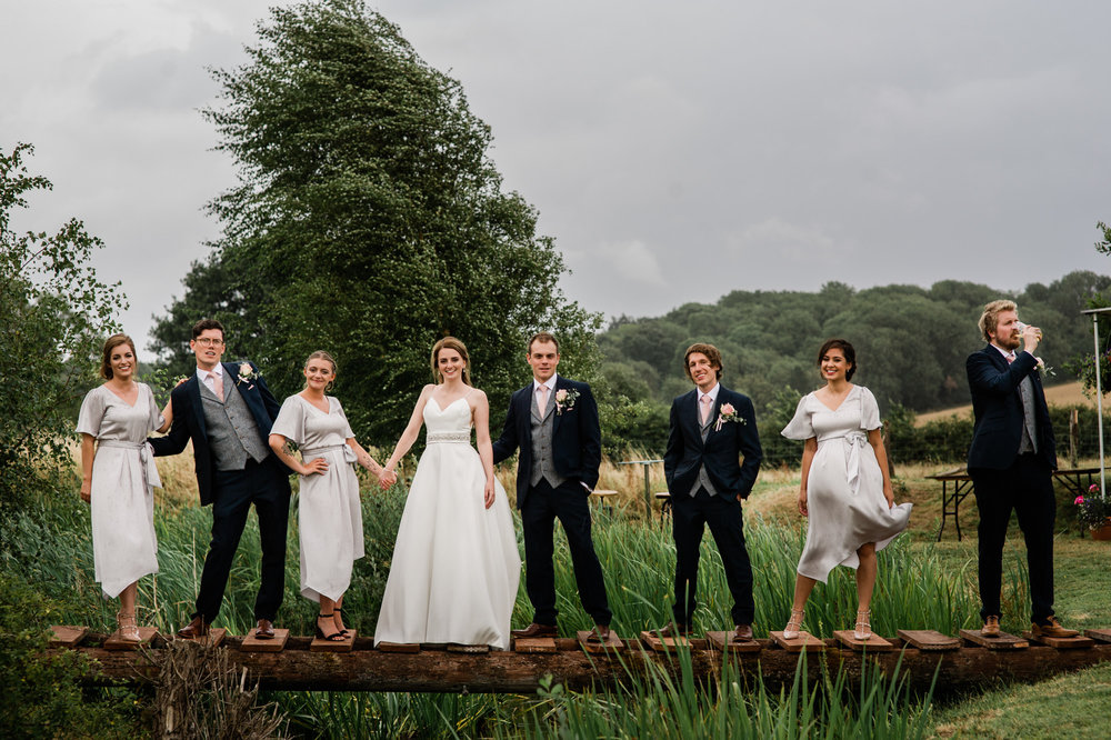 Wedding party stood on a bridge in Salisbury wedding photographer
