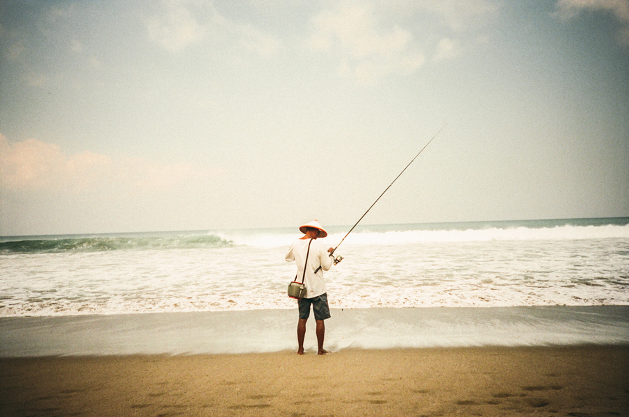 Fisherman along the beach in Seminyak, Bali.  (shot by: chris sembrot)