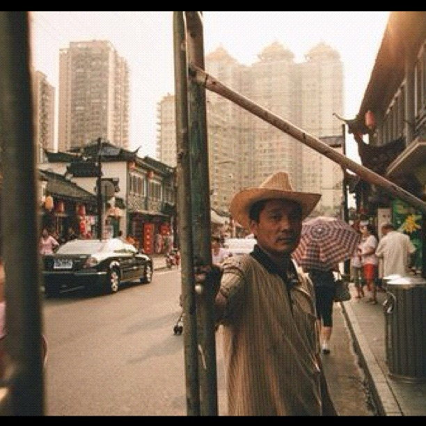 Image 4 from #magicmoon   Chinese (?) cowboy construction guy along the streets in Old Shanghai.  (Taken with  Instagram )