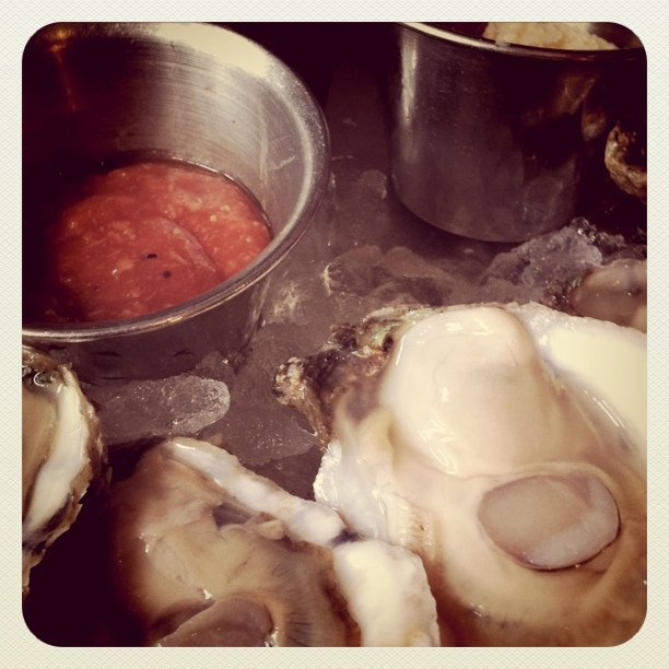#oysters next. $1 each. Not bad (Taken with  instagram )