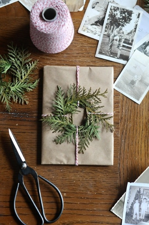ETHICAL GIFT GUIDE: WRAPPING   Reuse leftover tree trimmings as gift toppers via  Apartment Therapy .