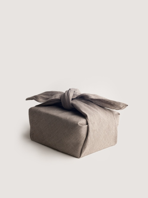 ETHICAL GIFT GUIDE: WRAPPING   This large furoshiki cloth can be used as an apron, a bread bag, a tote for carrying groceries and produce, a table or picnic cloth, or even a reusable gift wrapping option. The possibilities are endless. Includes cotton twill tie. Made in California. Available at  Art & Article .