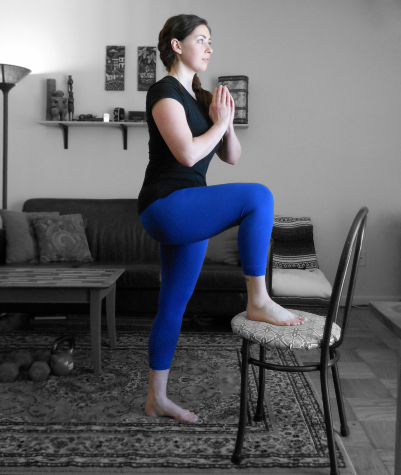 Standing back up, draw the working leg through and step onto the chair.