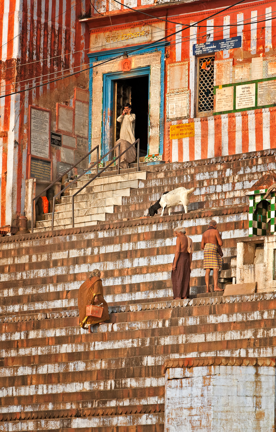 Climbing the steps to the temple, Varanasi, India