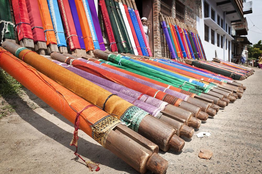 Woven sari on spindles, Varanasi