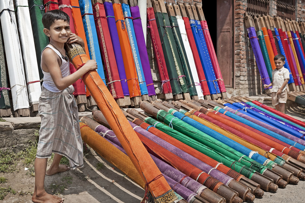Boy with woven material, Varanasi