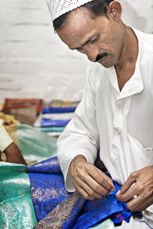 Checking sari, Varanasi