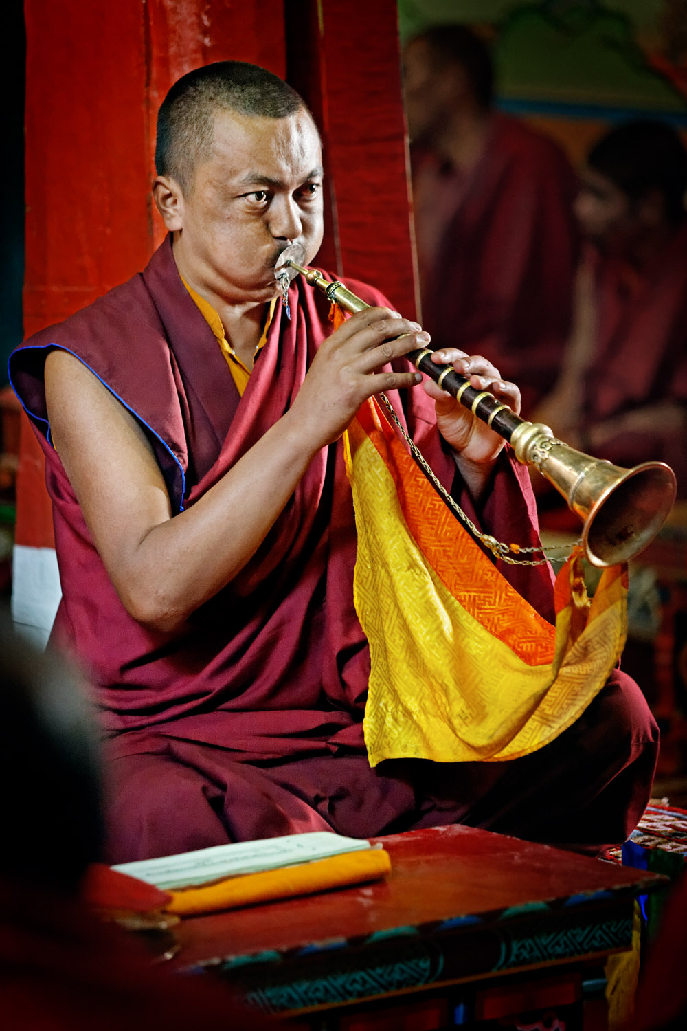 Monk blowing horn, Hemis Monastery