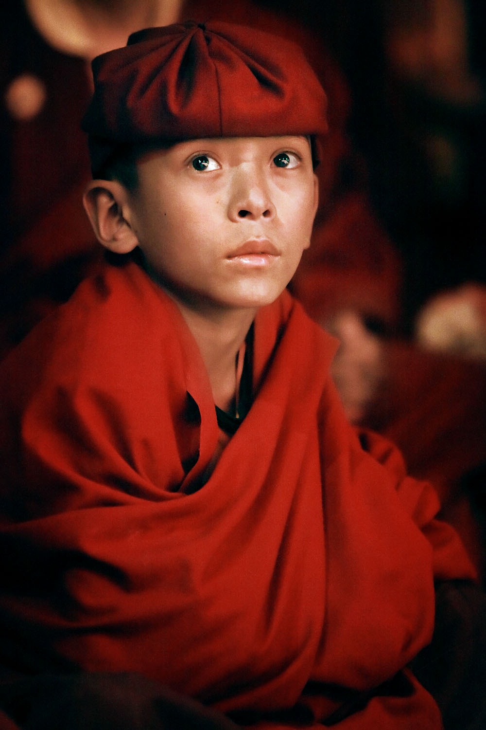 Young monk watching theatrical performance by Drukpa nuns, Hemis Monastery