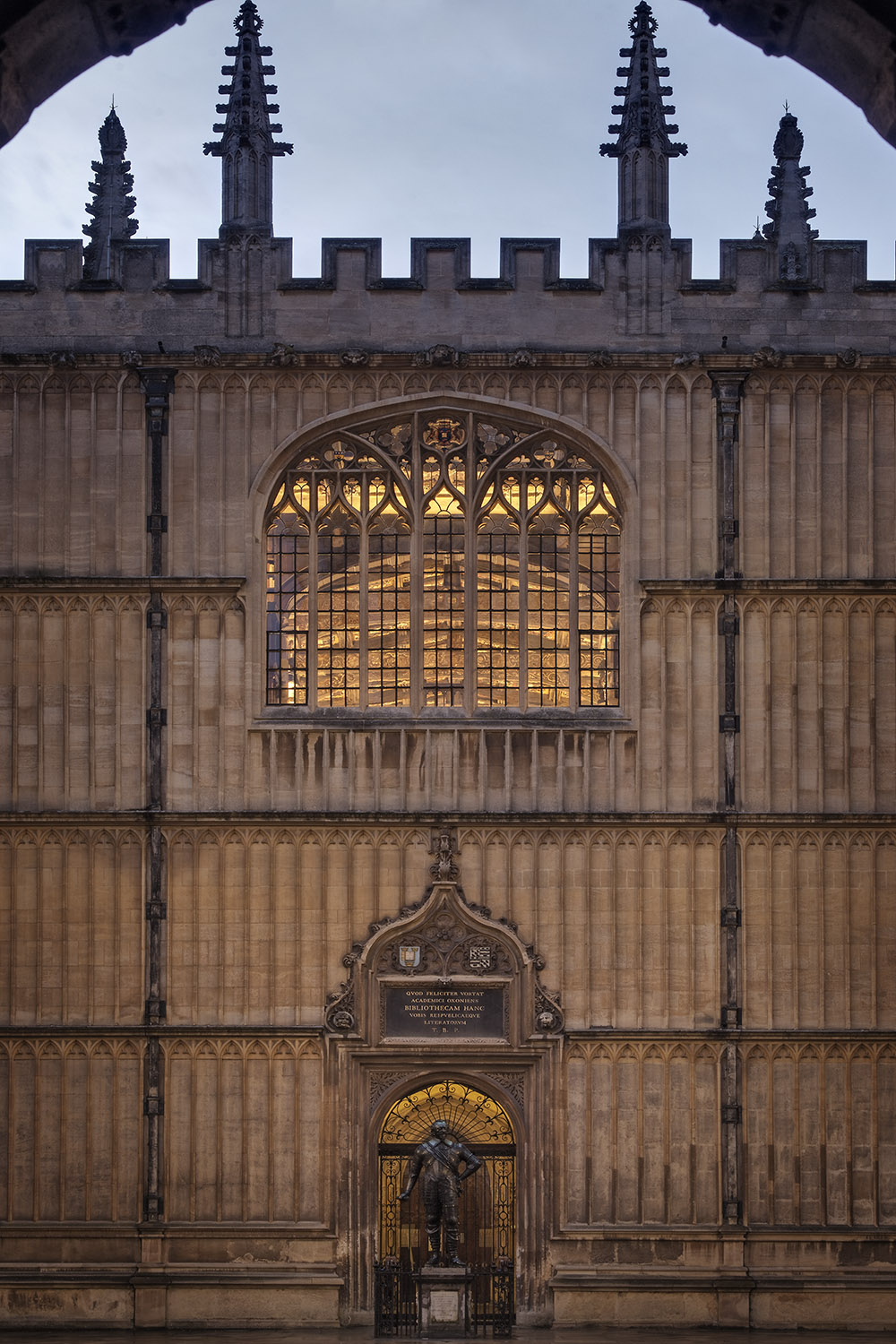 Photography by Dan Paton showcasing the new lighting installation by Urban Jungle and Oxford University Estates in Duke Humfrey's Library - the oldest part of the Bodleian Library, University of Oxford, Oxford, UK