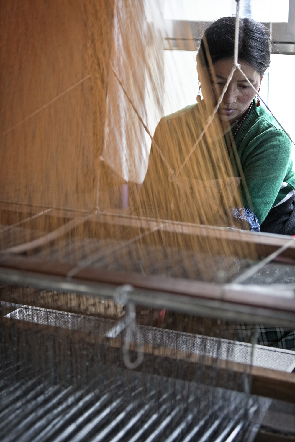 Weaving in the workshop at Norlha Textiles, Ritoma, Amdo, Tibet