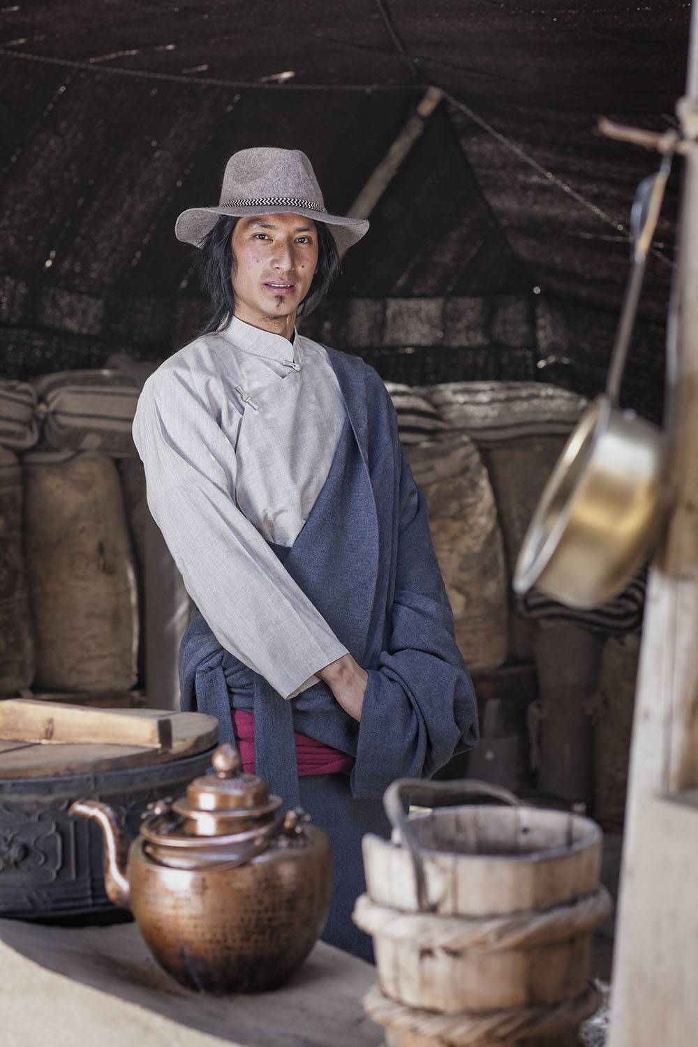 Traditional tent interior with Wangdi wearing Norlha textiles, Lungta Cooperative, Amdo, Tibet