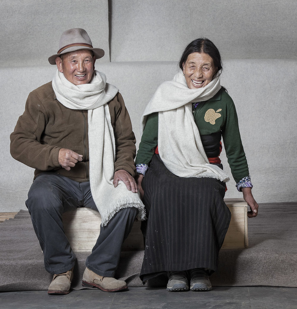 Husband and wife modelling shawls, Norlha Factory, Ritoma, Amdo, Tibet