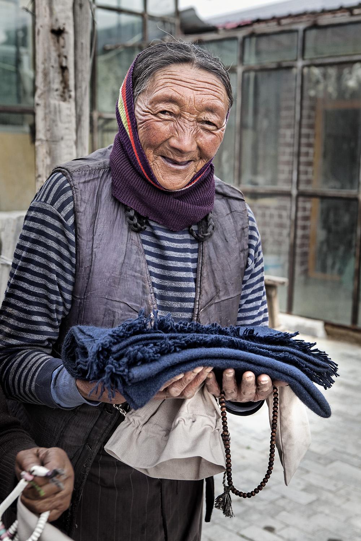 Happy Sagadawa! Everyone over 80 years old in Ritoma is gifted a new shawl. Norlha atelier, Ritoma, Amdo, Tibet
