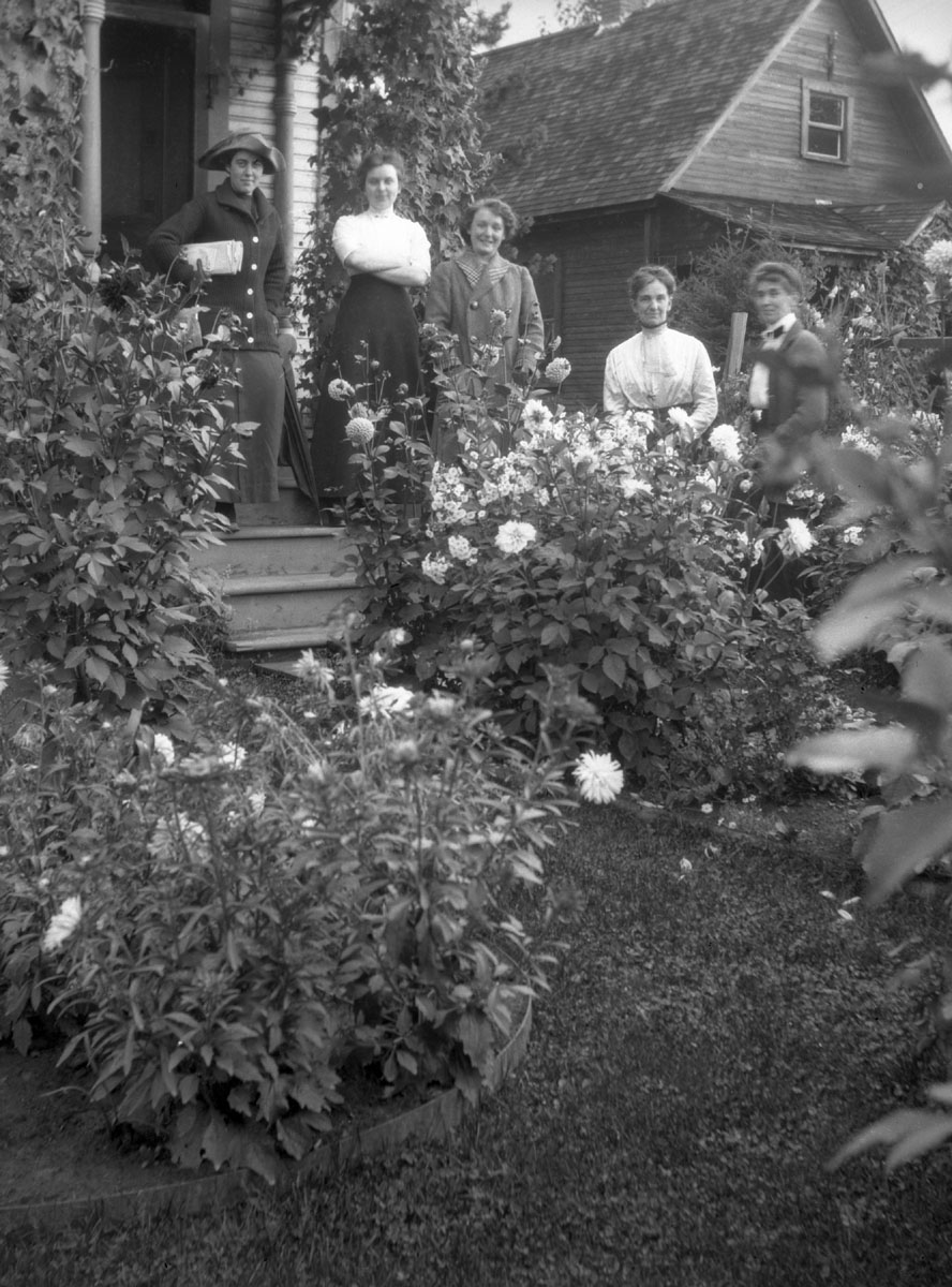Women Standing in Garden, c1910 [DN-985]