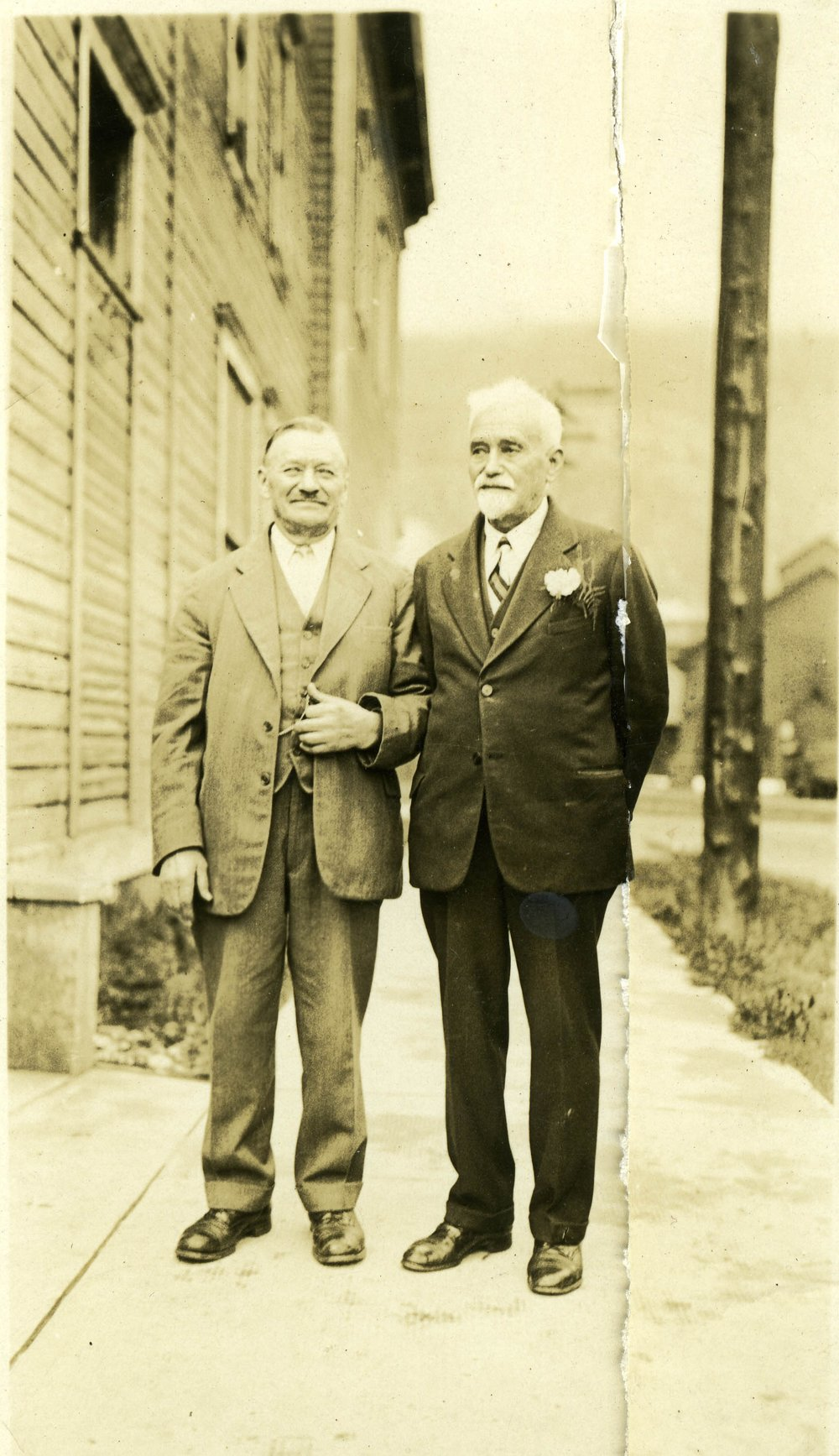 Dominic Gallicano (right) outside bakery, date unknown.