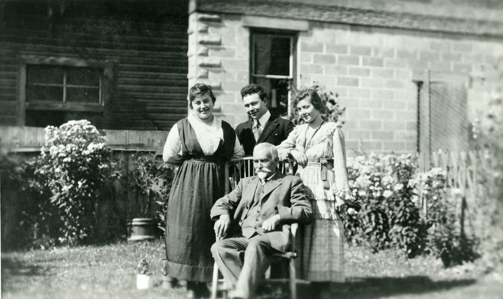 Dominic Gallicano (seated) with daughters Eda and Sylvia and son Tangree, c.1918.