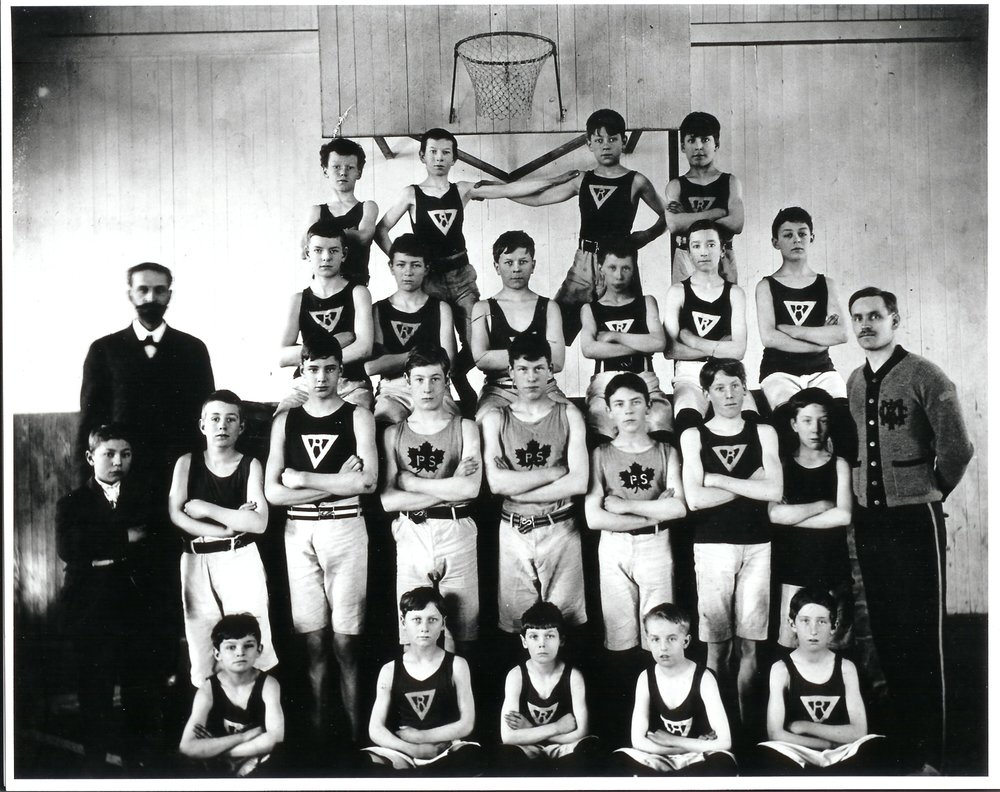 Revelstoke YMCA class, circa 1909. George Arnold McCarter is on the top row, 3rd from left; Douglas McCarter is on the next row down, 2nd from left.