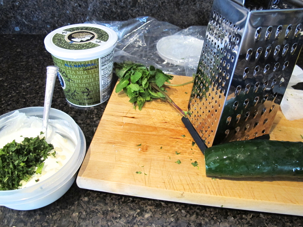 Grated cucumber, mixed with mint, lemon and yogurt make for a refreshing sauce