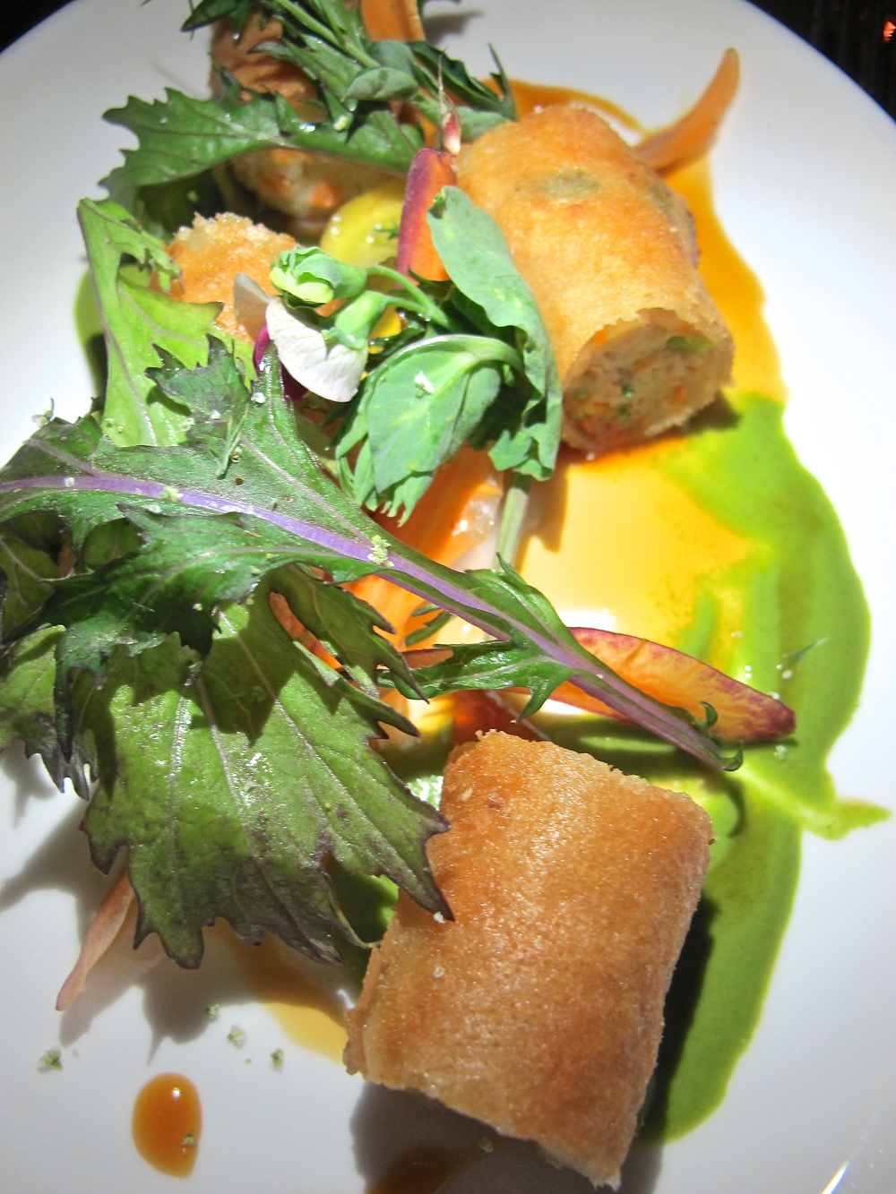 Basic egg roll?  Guess again.  Shrimp and rabbit sausage spring roll with mizuna, green curry.