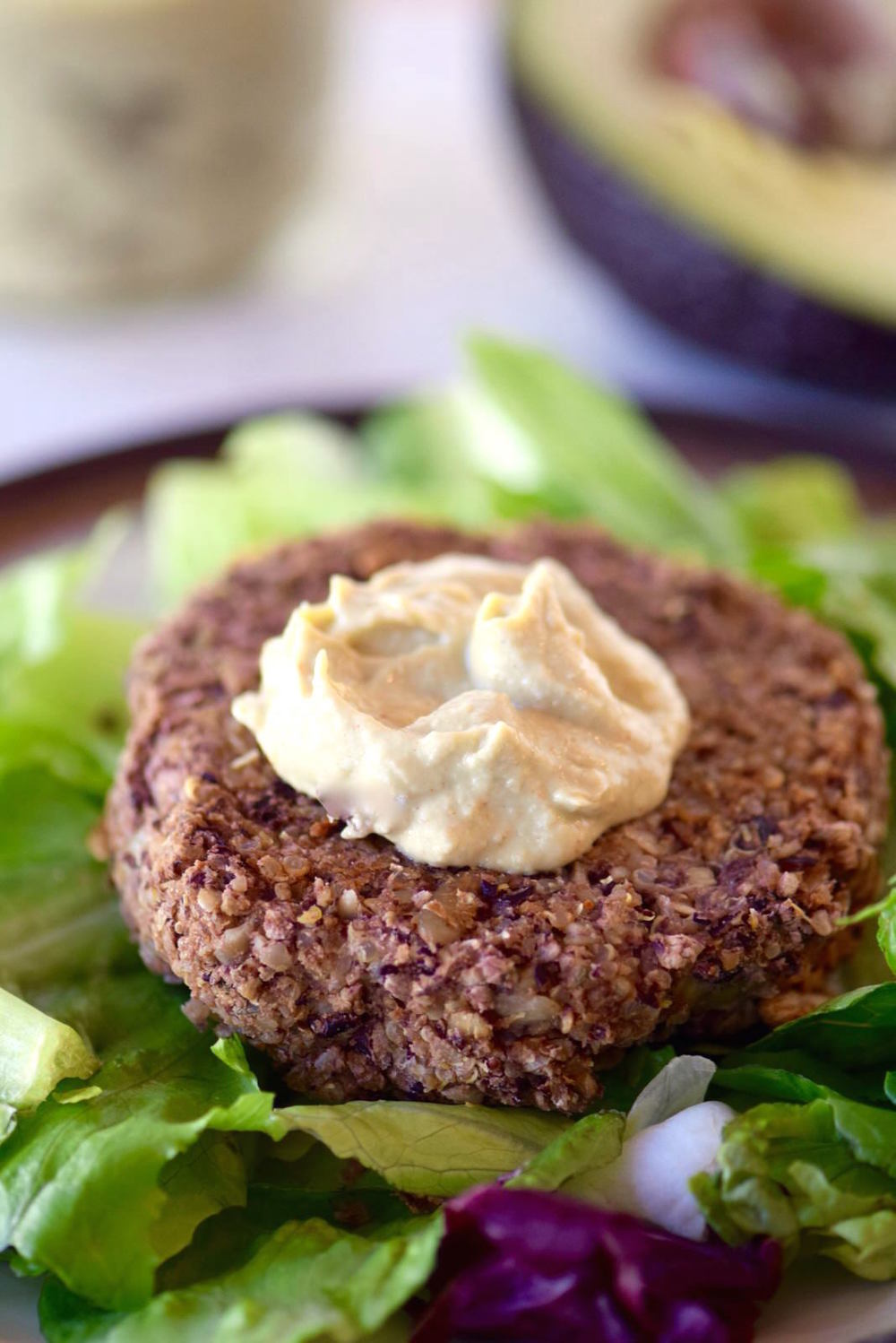 Avocado Tahini Sauce on Veggie Burger | TastingPage.com