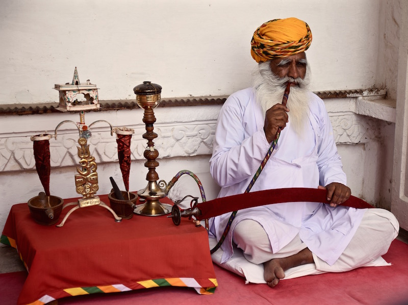 Indian man with hookah pipe