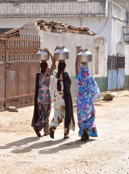 Indian women carrying water