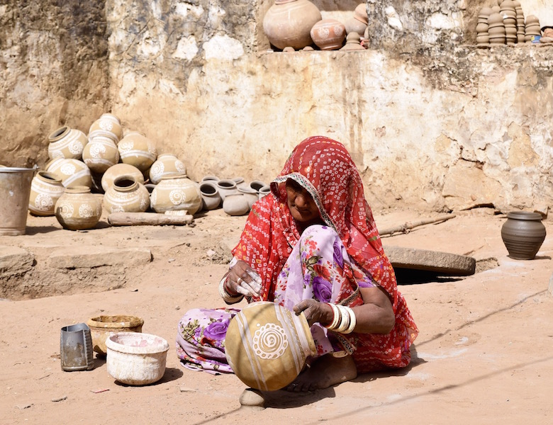 Indian woman painting pot.jpg