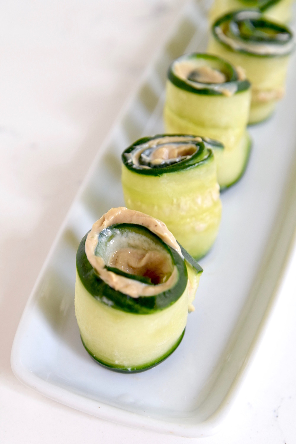 Sunflower Tahini Cucumber Roll Ups - a great gluten free, dairy free and nut tree after school snack | TastingPage.com