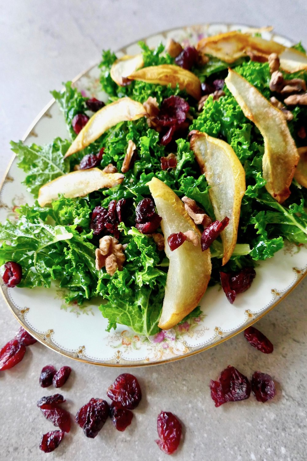 Cranberry pear walnut salad - paleo, vegan, whole30 friendly and great for a holiday dinner | TastingPage.com