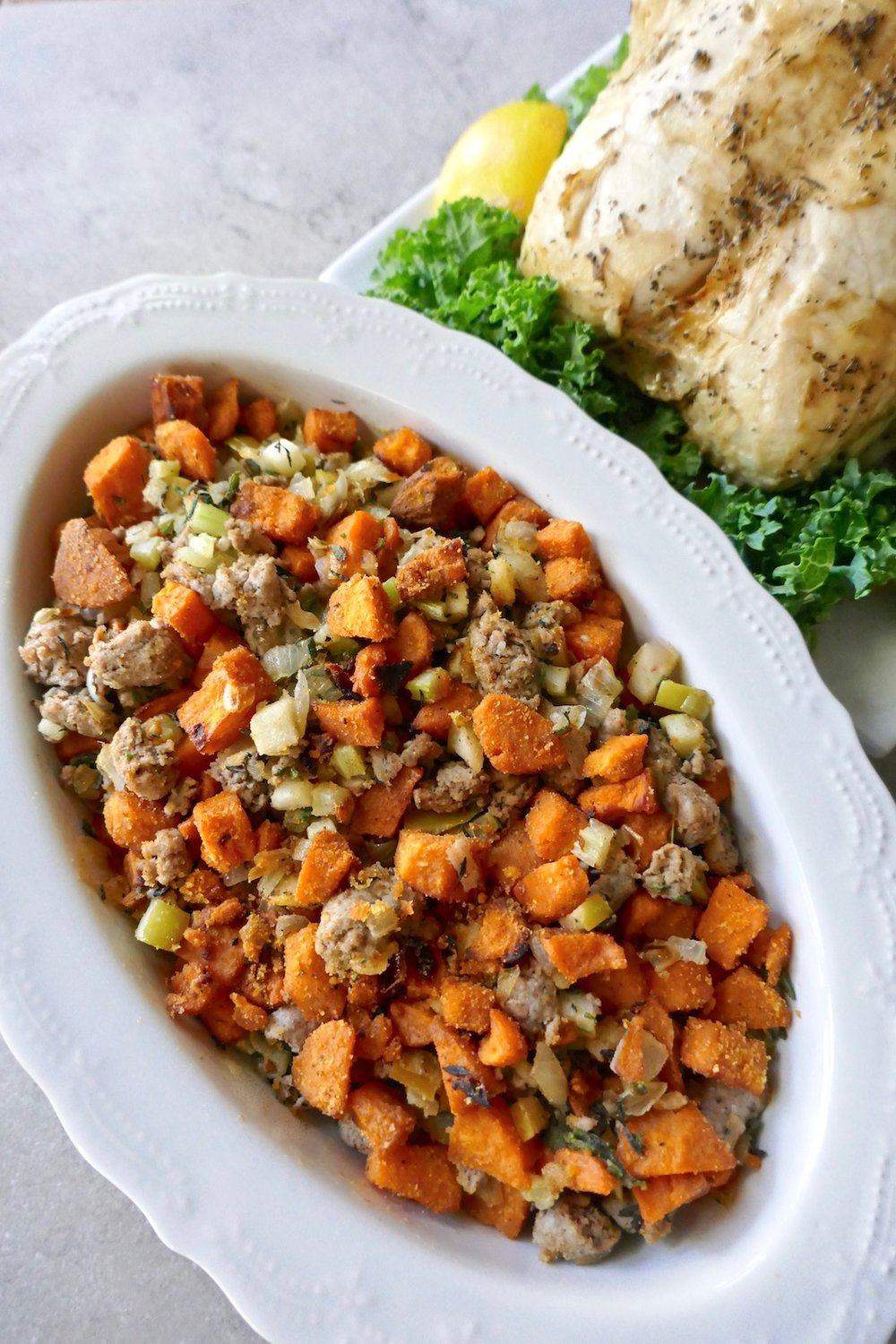 This healthy Paleo sweet potato sausage stuffing makes for a great Thanksgiving side dish or accompaniment to any night's dinner. The stuffing is grain free, gluten free, dairy free, and sugar free | TastingPage.com #stuffing #thanksgiving #thanksgivingrecipe #thanksgivingstuffing #grainfreestuffing #glutenfreestuffing #sausagestuffing #sweetpotatoes