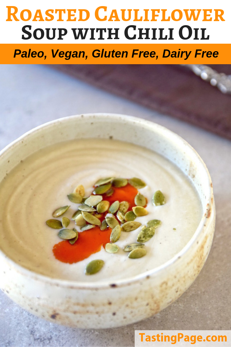 Roasted cauliflower soup with chili oil and toasted pepitas | TastingPage.com #soup #paleo #whole30 #paleorecipe #healthysoup #cauliflower #vegansoup #dairyfree