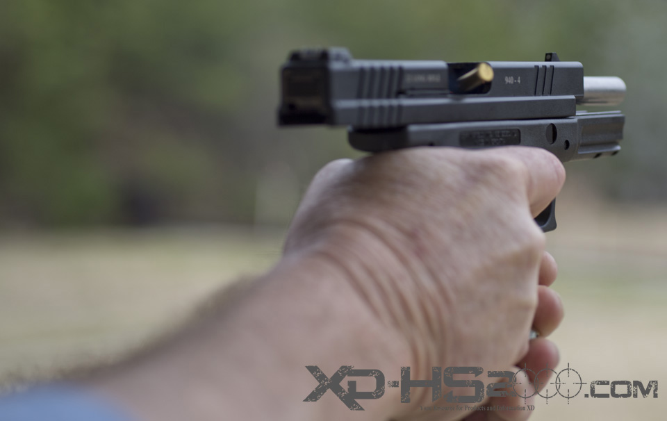 The XD conversion slide in full recoil.