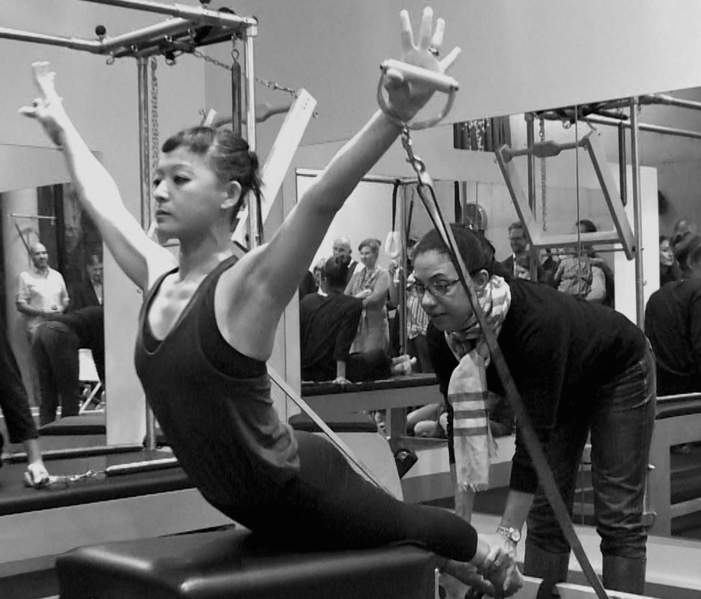 Cynthia Lochard and I doing the Breast stroke on the reformer for the studio's demonstration
