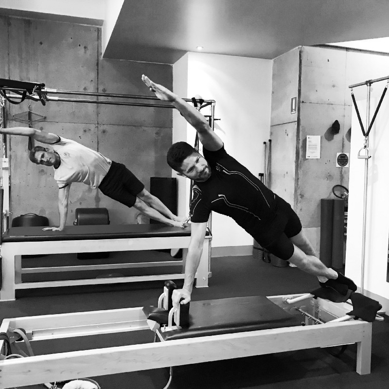 True Pilates Sydney Studio Instructors - Luke Cook and Pablo Comino training in the studio