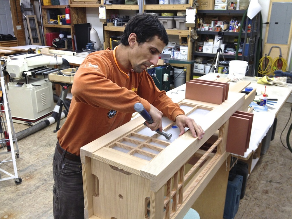 Mike Pasini assembles the lantern grid for the prairie chandelier which will be on display in the fine woodworking exhibition at the Museum of the Rockies