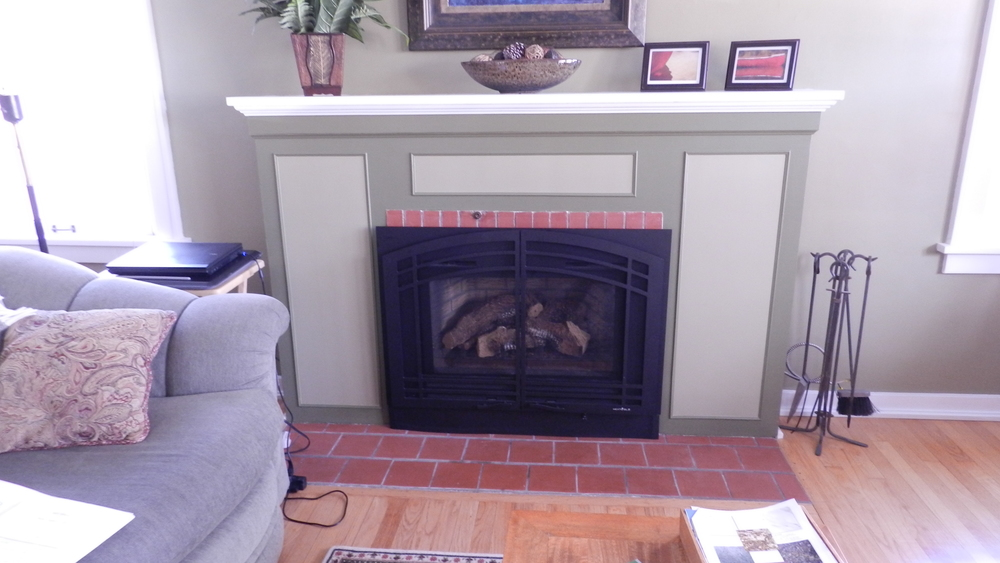 The original fireplace with an ill-fitting gas insert, poor design, and just outright hideous.