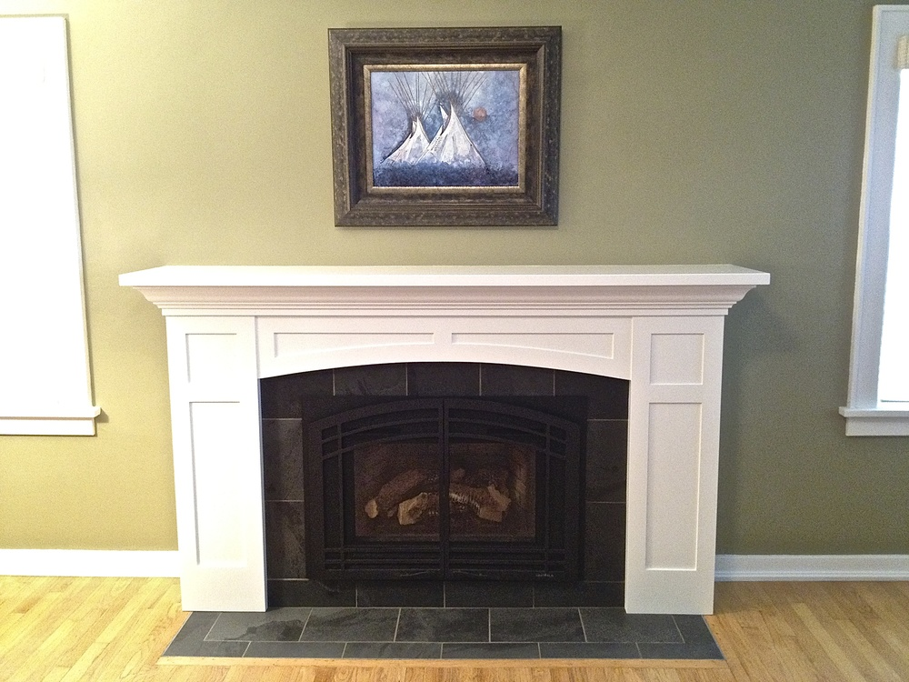 The fireplace surround installed and complete.
