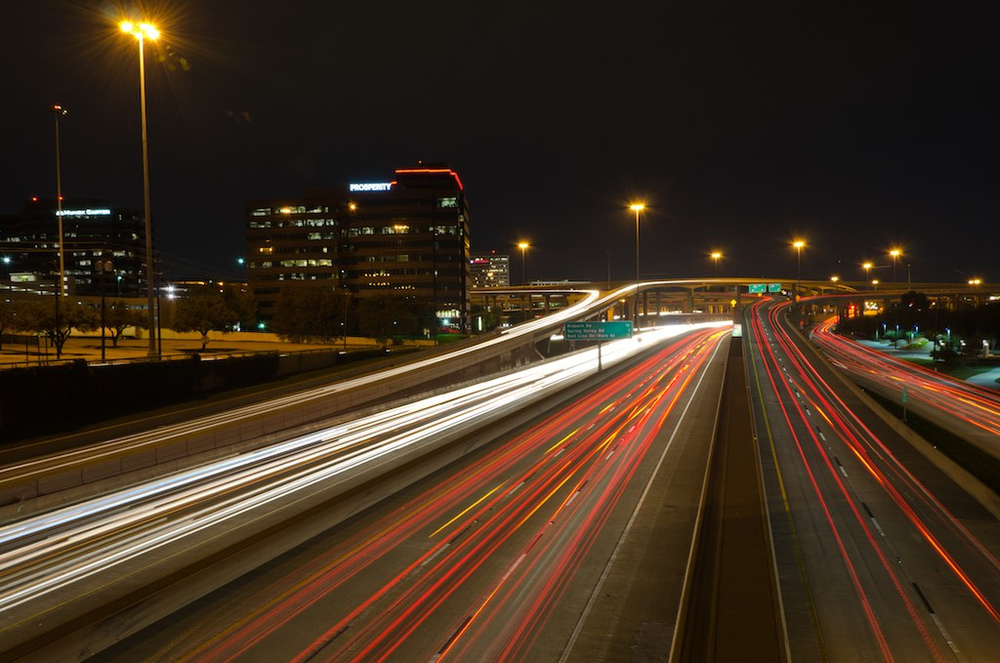 This is the infamous Hi 5 interchange in north Dallas. I'm standing on Churchill Way over Central Expressway (I-75) facing north toward the ramps to 635 LBJ Freeway. I love the car light trails in this shot.